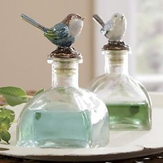 Decorative bottles with songbird stoppers... crafted in metal, hand-painted in enamel