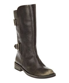 Boasting a sleek and sophisticated aesthetic mixed with a hint of western appeal, this ankle-hugging boot is crafted with a slouchy finish adorned with buckled straps.