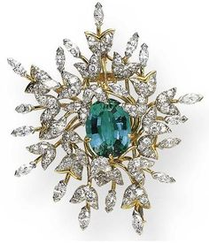 A DIAMOND AND GREEN TOURMALINE FOLIATE BROOCH, BY JEAN SCHLUMBERGER