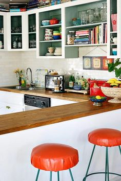 kitchen color. wood counters. shelf for cookbooks.