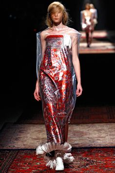 Maison Martin Margiela S/S 12. Rolled rug  still in the plastic. Genius.