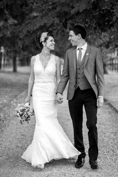 Vintage lace wedding dress, Jenny Packham headpiece, sharp grey suit, waistcoat, skinny tie, vintage badge... that was us :)