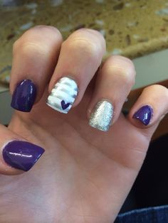 Purple and Gray nails Supplies: Paint in each color  Clear paint to seal down the tape stripes Scotch tape (for the gray stripes) Dotting tool (to make the heart) *you can make your own dotting tool out of a pencil and a flat-head pin*
