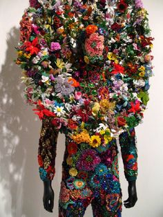 "Nick Cave's Sound Suits,  ""full body suits constructed of materials that rattle with movement, like a coat of armor, (they) embellish the body while protecting the wearer from outside culture."""
