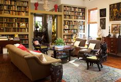 In the Soho loft of New York–based decorator Thomas Jayne and his partner, Rick Ellis, a wall of bookcases acts as a room divider and display pieces from the couple's extensive collection of books on American cooking and culinary history from the last 200-plus years.  Photo by Don Freeman.