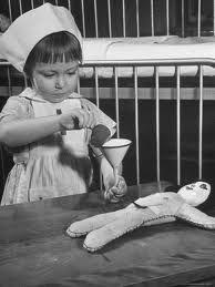 The wee nurse adimnstering a liiilt TLC