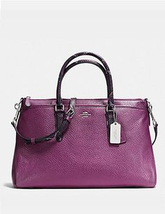 """Details: Classic leather with python-embossed leather trim Inside zip, cell phone and multifunction pockets Zip-top closure, fabric lining Handles with 4 1/4"""" drop Longer strap with 15 3/4"""" for should"""