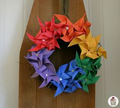 It's time to have some more fun with Rainbows and Pinwheels. We are celebrating St. Patrick's Day with 17 days of Food and Fun, and this week is all about Rainbows! On Monday, I shared our St. Patrick's Day Mantel with Rainbow Tissue Paper Flowers and yesterday we enjoy Mini Rainbow Cupcakes. Today…let's make a …
