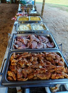 Buffet for a country wedding under and open barn. Herb chicken, dinner ham, smashed potatoes, green beans, coleslaw, yeast rolls.