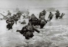 Robert Capa, American soldiers landing on Omaha Beach, D-Day, Normandy, France, June 6, 1944.
