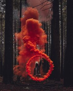 Cicle of smoke orange into forest trees green – Fotos – - Aesthetic Photography Smoke Bomb Photography, Color Photography, Creative Photography, Portrait Photography, Colourful Photography, Halloween Photography, Fashion Photography, Photography School, Photography Competitions