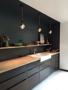 Almost black walls for kitchen, to complement cabinets