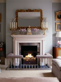 The pale blue drawing room is traditionally furnished with a club fender around the fireplace Fireplace Seating, Fireplace Hearth, Modern Fireplace, Fireplace Design, Fireplace Guard, Fireplace Facade, Inglenook Fireplace, Georgian Interiors, Georgian Homes