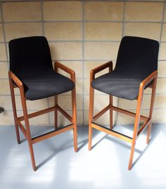 A lovely pair of vintage Danish mid century modern barstools in Teak. Hand made by Tarm Stole OG Mobelfabrik in Denmark, these stools have a classic Danish modern look and ergonomic comfort so perfected by the designers of the time. The seats are padded and very comfortable. The stools are in excellent condition with very little sign of use. The frame joints are tight and sturdy. The seat fabric has occasional light marking only visible in certain light. The original makers labels are on th... Danish Modern, Mid-century Modern, Modern Bar Stools, Denmark, Teak, Dining Chairs, Designers, Mid Century, The Originals
