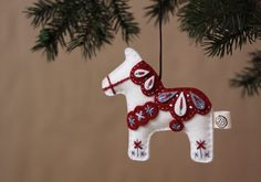 Items similar to Nikkie's Felt Dala Horse Christmas Ornament-White on Etsy Horse Christmas Ornament, Felt Christmas Ornaments, Christmas Fun, Swedish Christmas Decorations, Scandinavian Christmas Ornaments, White Christmas, Christmas Sewing, Christmas Projects, Holiday Crafts