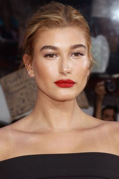 Who: Hailey Baldwin What: Bronze Glow How-To: Trying to fight NYC humidity is a losing battle; on hot nights, embrace dewy, glowy skin and lids like the model did. After sculpting with cream bronzer, tap gold illuminator along the tops of your cheekbones, down the bridge of your nose, across the brow bones and on your Cupid's bow, then add a wash of sheer, shimmery taupe shadow.   - HarpersBAZAAR.com