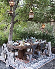 """I love the way they've used the outdoor rug to create a """"room"""", reclaimed wood look and industrial Tolix type chairs to create a modern, casual place to dine. #OutdoorRugs"""