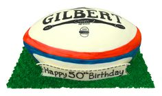 Rugby Ball on Grass sculpted cake hand painted fondant cover