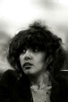 Stevie Nicks with her amazing Tusk era perm and bun c. 1979. Seriously cool and so elegant.