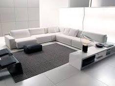 Esto es nuestro salon. Es muy grande y moderno y tiene un sofa de esquina. hay también un sillon.