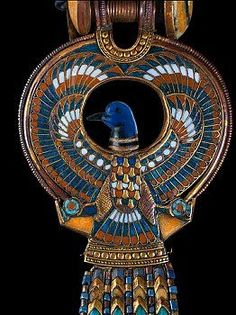 Cloisonne earring from tomb of Tutankhamun The central feauture is described as a falcon with a duck's head its wings creating a sweeping circle around its head and its talons clutching shen rings, beneath the tail feathers is a bar decorated with circles from which hang five strings of gold and glass beads ending in pendant uraei. | Located in: Egyptian Museum,
