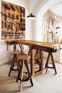 """A carpenter table is used as bar seating. The stools are by Tom Dixon. Green enamel vintage pendant lights from the fifties were sourced in the UK. (via : Remodelista)"""