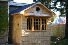I knew I would never build a house. So that shed would be the closest thing to it. So my shed's got stained glass. The cedar shingles will age nicely and are maintenance free.