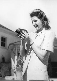Rita Hayworth taking home movies, 1941