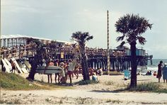 Cape Canaveral pier 1970. Now 2014 surrounded by parking lots hotels and homes