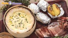 Facciamo una piccola digressione oltralpe con Sonia Peronaci.  Il Vacherin Mont d'Or (formaggio svizzero DOP) al forno, con vino bianco, erbette e patate al cartoccio.    Se non l'avete mai provato è davvero ora di farlo!