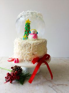 Eggless red velvet cake/snow globe cake - rich and moist cake for any occasion.A show stopper cake which is easy to make and delicious to eat.