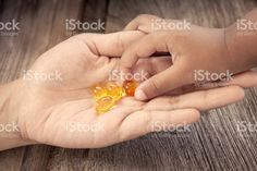 child picks Cod liver oil omega 3 gel capsules royalty-free stock photo