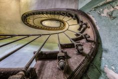 """Buy enter the past  limited edition 1/7, a Color on Paper by christian richter from Germany. It portrays: Architecture, relevant to: perspective, rotting, spiral, staircase, stairs, steps, colorful, arcitecture, decay, abandoned, old abandoned spiral staircase in old mansion  on Hahnemühle Photo Rag 308g signed, numbered and with 3cm white border.        i sell this print in another limited collection of 3 available in 100x150cm (about 40""""x 60"""") on request."""