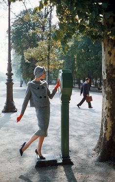 """Model is wearing a herringbone tweed """"bag"""" dress with matching jacket and hat by Pierre Cardin, photo by Mark Shaw in the Tuileries Garden, Paris, Sept. 1957   by skorver1"""