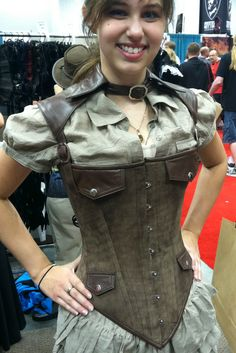 Collared Steampunk Corset  I like the short sleeve shirt with this.  Add neat pants and accessories... Would be nice.