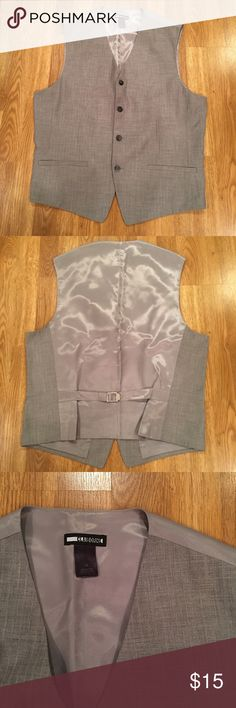 Men's Claiborne Suit Vest In great condition vest from Claiborne. It is gray with smiley gray buttons and a gray satin like back. It's a size medium. Claiborne Suits & Blazers Vests