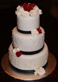 Top two tiers and change the colour of ribbon and flowers