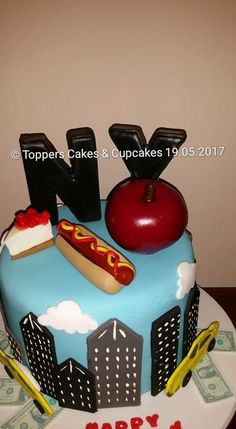 New York Themed Birthday Cake Complete With Handmade Decorations Including Hot Dog And Strawberry Cheesecake