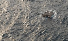 """A Japanese home drifts in the Pacific Ocean in this photograph taken on March 13, 2011 (via Atlantic's """"In Focus"""" blog)."""