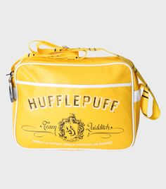 A satchel bag featuring the Hufflepuff crest, with a main zip up compartment and internal zipped pocket. The bag comes with fully adjustable straps, and measure