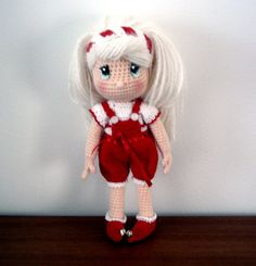 Free Amagurumi pattern: Holiday Doll with clothes.