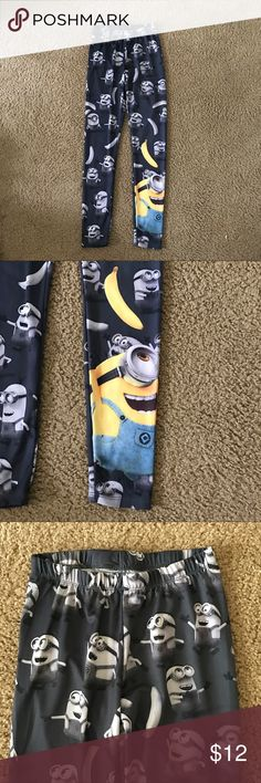 Despicable Me Minions Leggings Yoga Pants A gently used black pair of leggings by Despicable Me Minion Made in a size xsmall. In a minion print with Kevin, Stuart, and Bob it has a minion on the left bottom.   ✨ Ask me about free shipping! 💕 Always ships within 2 business day 🚫 I do not trade Despicable Me Minion Made Pants Leggings