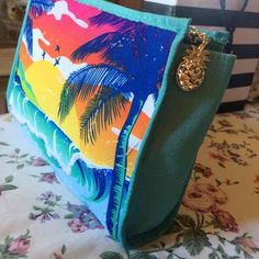 New tropical bag Sun setting with palm trees and ocean waves make up bag by Bath and body works. Can be used as a cosmetics bag or anything. Beautiful tropical design never used! small bag Bags Cosmetic Bags & Cases