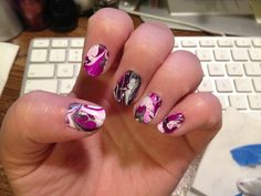 https://flic.kr/p/cwzRR1 | 1st marbled nails trial | This is my first attempt at doing the marbled nails thing. I know, I'm not much of a girly girl, but I like doing nails once in a while! I put the top coat on too soon, so the purple ran...  And I could not, for the life of me, get a good photo. But this one was the best of the bunch.  As I sit here and type, I'm now noticing how much my thumbs collide!  XD