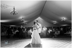 First dance with beautiful draping and wrought-iron chandeliers. Photo courtesy of Heather Cook Elliott photography