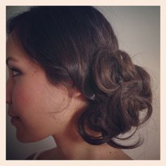 Side curls pinned up.