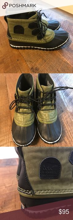 Sorel Out 'n About Boot Sorel rain boots in excellent condition! These are a sample, so you will likely not find this same color/print in stores. There is a tiny spot on the side of the boot, possibly glue? Please see pics! Also the sole inserts are different colors. Sorel Shoes Winter & Rain Boots