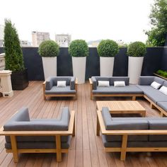 potted shrubs - oversized pots - outdoor sectional - dark grey, light grey, brown, and white color combo