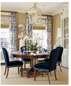 Chinoiserie Chic: Sunday Inspiration  love those navy chairs and lighting and china cabinet