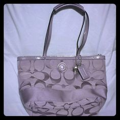 """Authentic Coach Signature stripe tote Coach Signature stripe lilac tote, dual straps 7"""" drop. L13"""" X H9"""" X W3.5"""". Used a few times. No visible wear or tear. Stain on bottom shown in picture. No duster bag. Coach Bags Totes"""